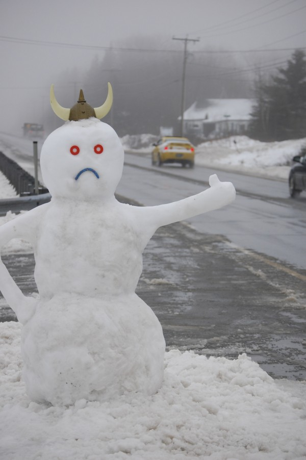 A snowman on Route 1 in Steuben is trying his best to hitch a ride to colder climes just before noon on Friday, as rain began pelting him into oblivion. The hitcher was created after Thursday's wet snowfall by teenagers Aaron Stanwood and Tyler Norton. The snowman features a different face on either side of his head, smiling for drivers heading toward Ellsworth and frowning for those traveling toward Machias.