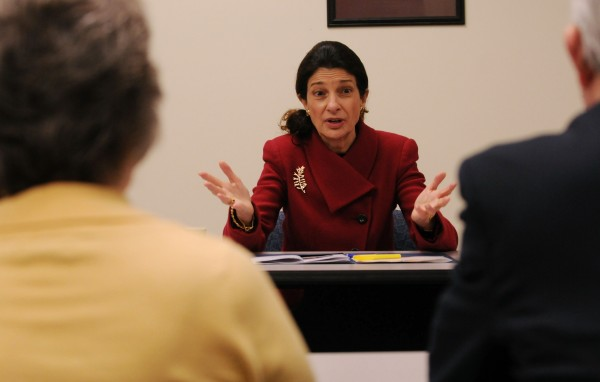 Jean Bridges, Child Develpoment Director at Penquis (left) and Charlie Newton,  CEO of Penquis (right), listens as Sen. Olympia Snowe talks about LIHEAP cuts.