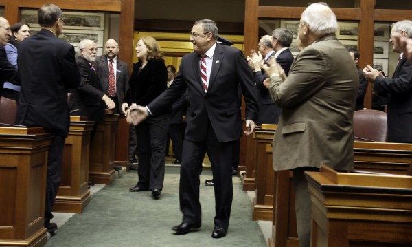 Maine Gov. Paul LePage is welcomed by members of the Legislature prior to delivering his first State of the State address at the State House in Augusta, Maine, on Tuesday, Jan. 24, 2012. LePage focused on job creation, education and energy during his speech.