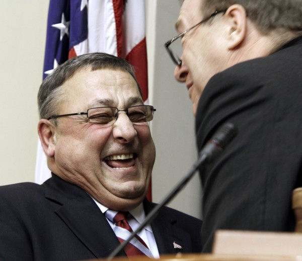 Maine Gov. Paul LePage (left) is welcomed by Senate President Kevin Raye before delivering his first State of the State address at the State House in Augusta on Tuesday, Jan. 24, 2012.