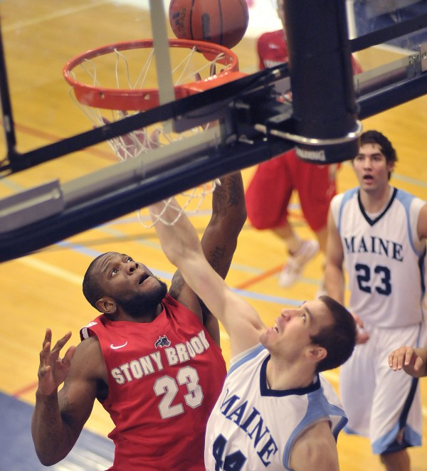 Stony Brook men's basketball player Dallis Joyner (23) puts up a shot over Maine forward Mike Allison (44) in the first half of their game in Orono on Saturday Jan. 21, 2012.