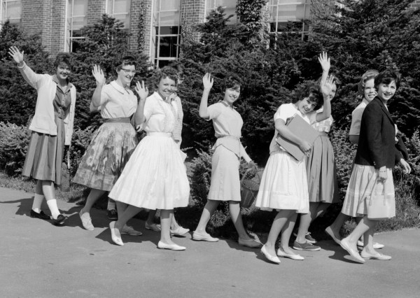 The Bangor public school system opened its third annual summer session in July 1961 with 356 of the 365 registered on hand for the opening classes. This group of girls looked anything but sad as they went to classes at the Garland Street Junior High School.