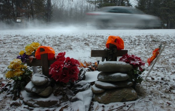 During a snow storm on Jan. 12, 2012, a car blurs past the adorned memorial for two Hermon High School students who died at this Irish Road site in Carmel on Nov. 8, 2011. James McPhearson, 16, of Levant and Richard Picken Jr., 14, of Carmel were killed instantly in the crash.