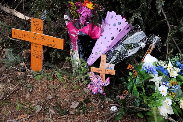 Flowers placed by friends and family members of Rebecca Mason, 16, and Logan Dam, 19, are seen at the site of the car accident that killed them both, on Route 219 in West Paris. The driver, Kristina Lowe, 18, of West Paris, is in critical condition at Maine Medical Center in Portland and another passenger, Jacob Skaff, 22, of South Paris, suffered a head injury.