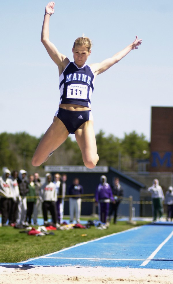 UMaine's Viktoriya Rybalko competes in the long jump during the America East track and field championships at UMaine's Beckett Track Complex in Orono in May 2003. Rybalko has returned to UMaine as an assistant coach with the track and field team.
