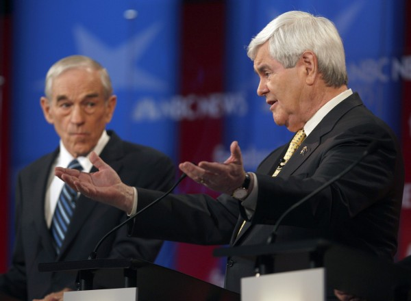Republican presidential candidates former House Speaker Newt Gingrich (right) and Rep. Ron Paul, R-Texas, participate in the Republican presidential candidate debate in Concord, N.H., on Jan. 8, 2012.