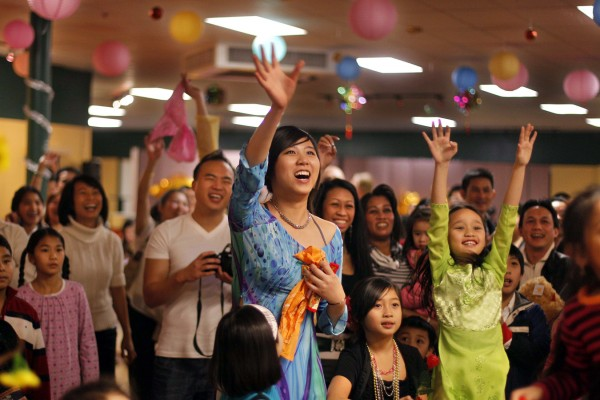 A crowd cheers during a performance by singer Don Ho during a celebration of the Vietnamese Lunar New Year, Saturday, Jan. 14, in Portland.