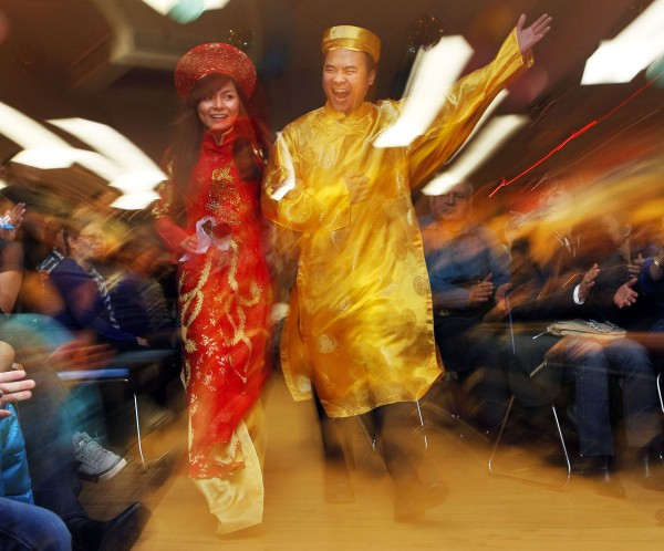 Participants in a fashion show show off formal wear during a celebration of the Vietnamese Lunar New Year, Saturday, Jan. 14, in Portland.