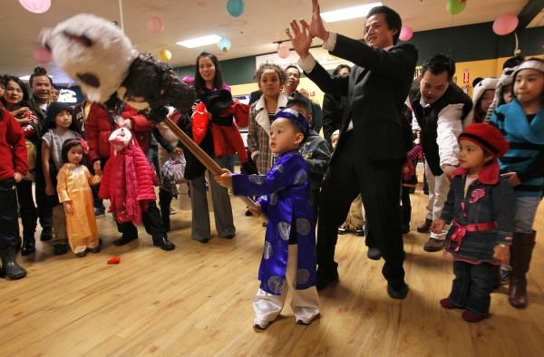 Kendrich Nguyen, 3, swings a stick at a panda pinata filled with candy at the Vietnamese New Year's celebration, Saturday, Jan. 14, in Portland. Pinatas are generally associated with Mexico, but the game has its origins in Asia.