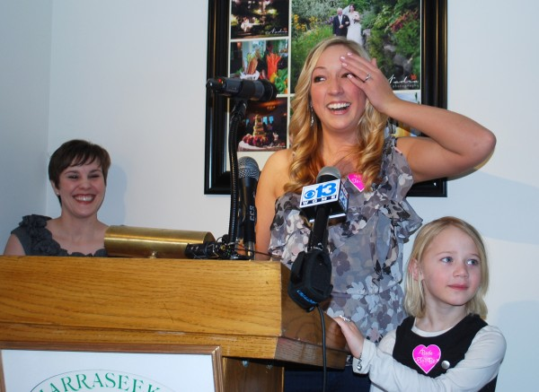 Laura Plaisted of Kennebunkport reacts after being named the winner of the Real Maine Wedding of the Year contest in April 2011. Also pictured are Melanie Brooks of Real Maine Weddings Magazine and Laura''s niece Savahana.