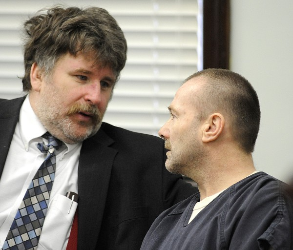 Brian Nichols (right) confers with his attorney Donald Hornblower in Androscoggin County Superior Court in Auburn, Maine, on Friday, Jan. 13, 2012. Nichols is using an insanity defense to charges he murdered his wife because he thought she was having an affair. Nichols is charged with murder in the May 8, 2010, shooting death of his wife, Jane Tetreault.