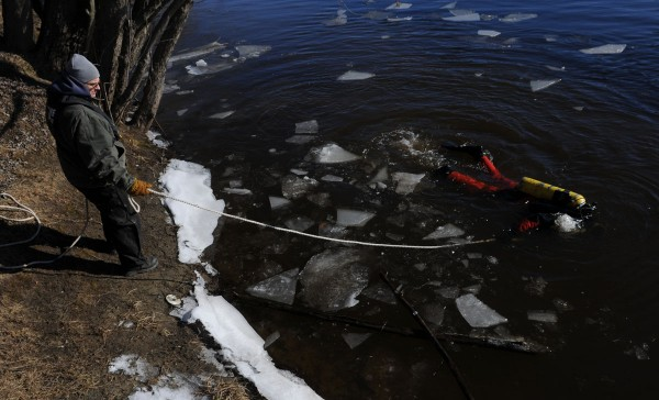 Members of the Maine State Police Dive Team search the waters of the Kennebec River just south of Waterville on Wednesday, Jan.11, 2012, for 20-month-old Ayla Reynolds.