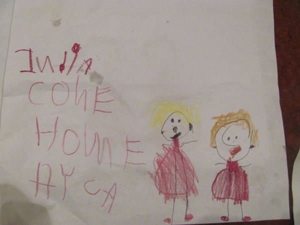 A drawing by a child, which was displayed at a candlelight vigil for Ayla Reynolds on Tuesday, Jan. 17, 2012 in Waterville, illustrates that people young and old are praying for the missing girl's safe return.