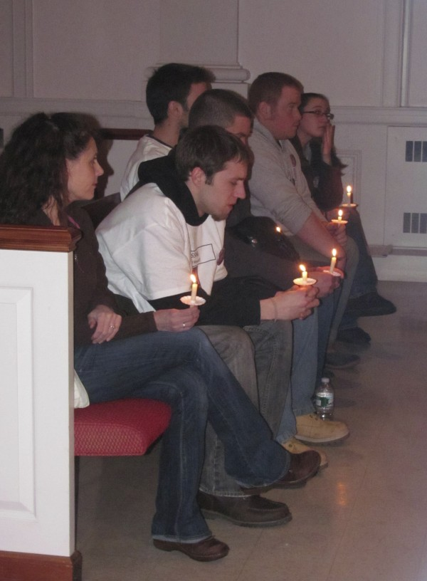 Justin DiPietro (second from left), who is Ayla Reynolds' father, sits with family and friends on Tuesday, Jan. 17, 2012, at a candlelight vigil for his daughter.