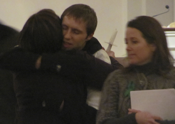 Justin DiPietro, father of Ayla Reynolds, embraces Danielle Bartz, who organized a candlelight vigil for Ayla on Tuesday, Jan. 17, 2012.