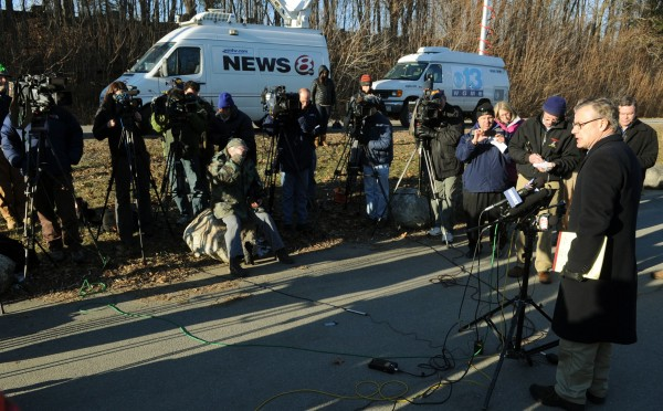 State Police spokesman Stephen McCausland (right) updates members of the media on Wednesday, Jan. 11, 2012 regarding the search for Ayla Reynolds taking place on the Kennebec River in Waterviille.