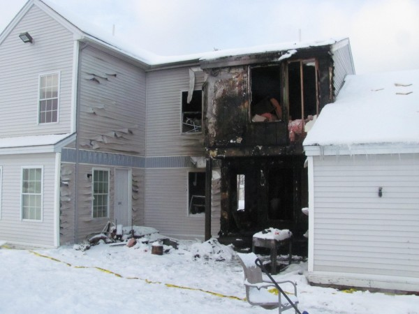 A fire that started late Monday, January 16, 2012, in a dryer vent destroyed this apartment at 20D Windjammer Way in Bath and caused significant damage to the adjoining apartments. A propane tank on a gas grill, shown in the foreground, added to the severity of the blaze.
