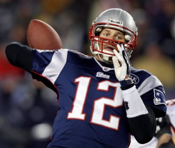 New England Patriots quarterback Tom Brady reaches back to pass during the second half of an NFL divisional playoff football game against the Denver Broncos Saturday, Jan. 14, in Foxborough, Mass.