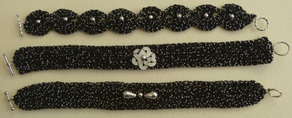 These bracelets were crocheted with cotton and metallic thread and embellished with silver-color beads and sequins.
