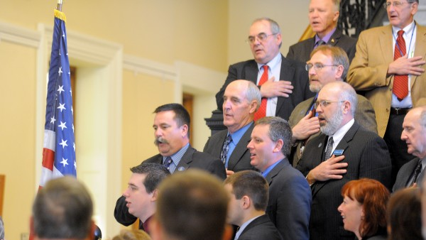 Maine legislators recite the Pledge of Allegiance during a signing ceremony for &quotA Call to Prayer for Maine&quot in the Hall of Flags at the Maine State House in Augusta Tuesday.