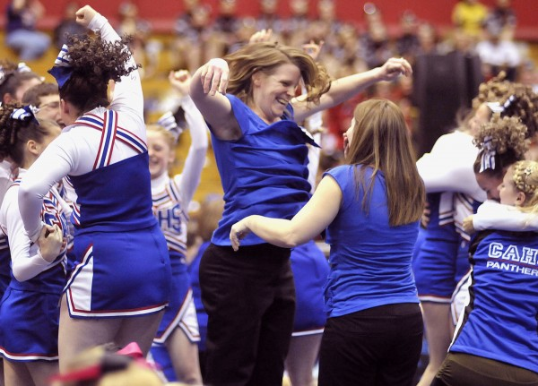 The Class D Central Aroostook cheerleaders and coach Sami Jo Allen (center) celebrate their first place finish in competition Saturday, Jan. 28, 2012, at the Bangor Auditorium.