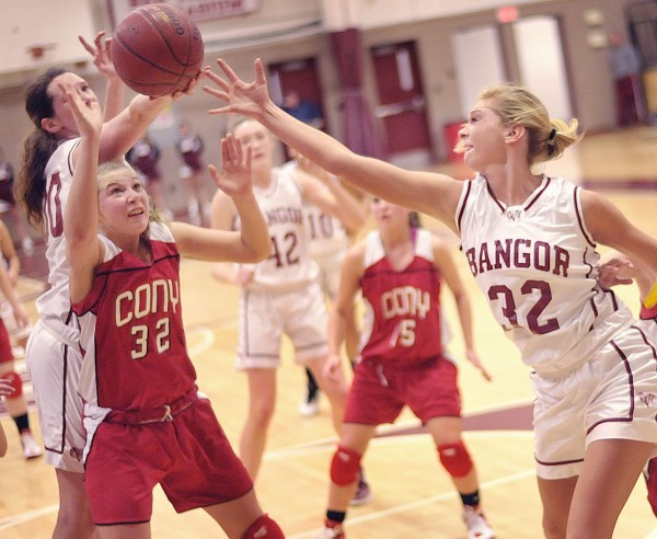 Bangor girls basketball players Katie Brochu (left) and Kayla Snow (32) grab for a rebound from Cony player Amelia Mia Diplock (32) in the second half of their game in Bangor, Maine, on Friday, Jan. 6, 2012.