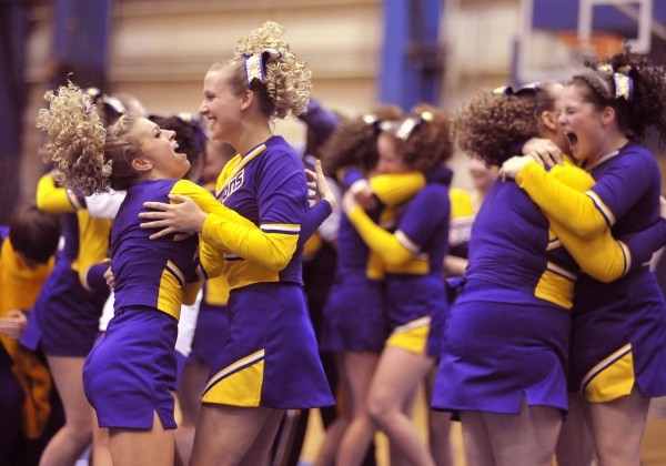 The Class D Woodland Dragons cheerleaders celebrate their second place finish in competition Saturday, Jan. 28, 2012, at the Bangor Auditorium.