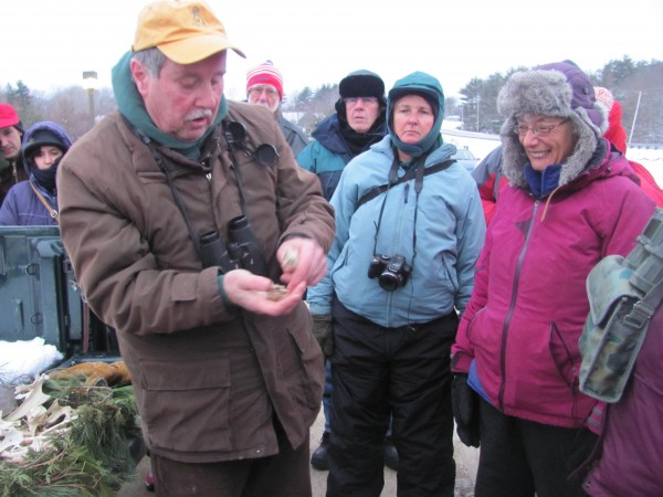 Bird enthusiast Don Reimer of Warren shows the remains of animals eaten by eagles to a crowd of about 35 people who turned out for an eagle watch early Saturday, Jan. 21, 2012.
