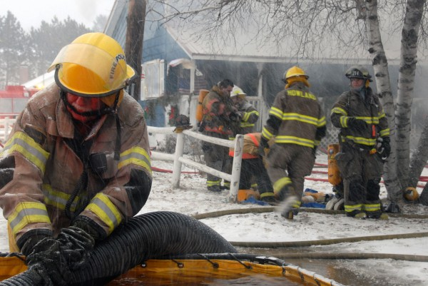 Firefighters from five northern Penobscot County towns trucked water to the scene despite blizzard-like conditions but were unable to save from destruction a 1 1/2-story house and attached garage at 91 Old County Road in Enfield on Thursday, Jan. 12, 2011.