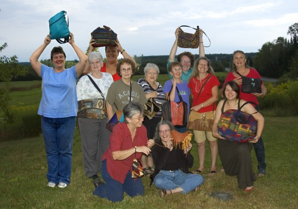 The employees of Erda in 2010. Erda, a small business based in Cambridge, Maine, produces handmade artisanal handbags made of deerskin, upholstery textiles, cowhide and recycles animal skins.
