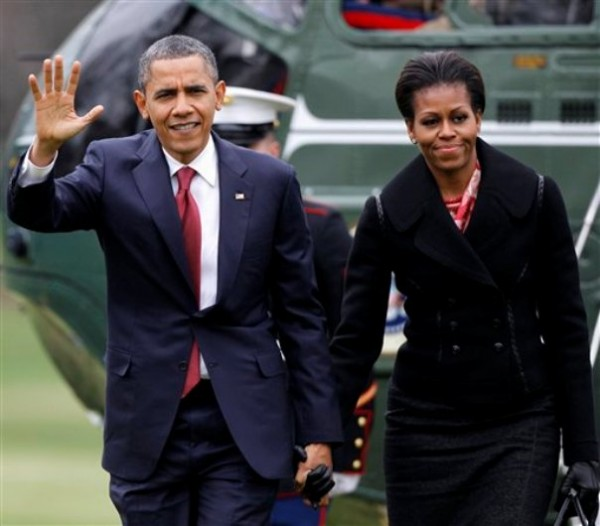 President Barack Obama and first lady Michelle Obama arrive on the South Lawn of the White House in Washington.