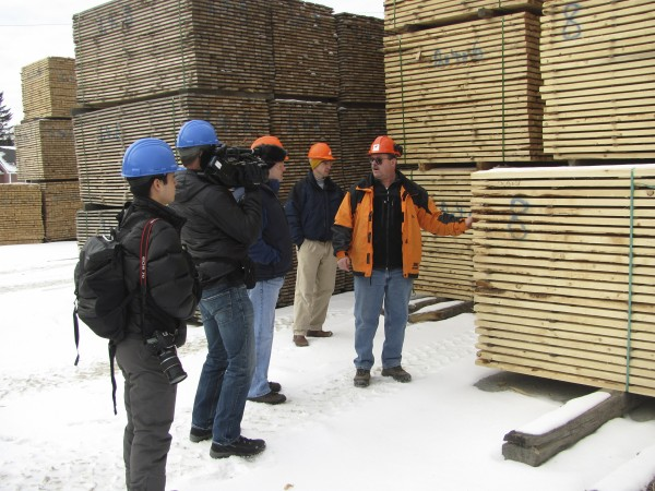 Steve Banahan (far right), the sales manager for Moose River Lumber Co. in Jackman, talks to two cameramen (far left) who visited the lumber mill on Wednesday, Jan. 11, 2012. The film crew visited the mill as part of a school curriculum being developed by The Nature Conservancy and Discovery Education, the education branch of the Discovery Channel.