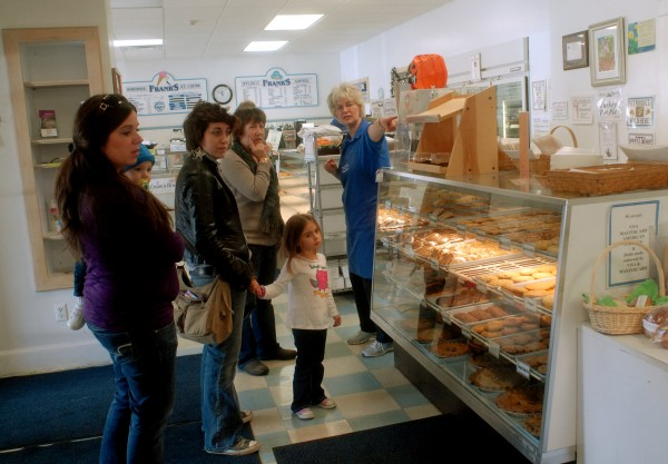 Carol Worster, an Frank's Bake Shop employee, helps customers in October 2010.