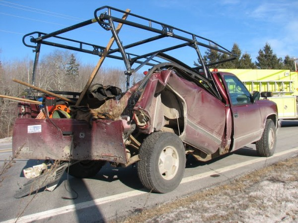 A 1996 GMC pickup truck sits bent and empty by the side of Route 1 in Hancock on Thursday, Jan. 19, 2012, after it was involved in the three-truck collision on the road around 1:15 p.m. All three men who were in the truck were transported by ambulance to an Ellsworth hospital with injuries that were not life threatening.