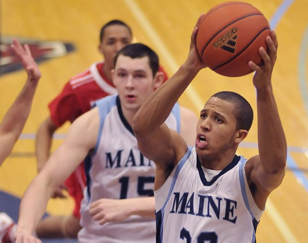 Maine men's basketball player Gerald McLemore (32) drives to the basket for a shot in the second half of their game against Hartford in Orono, Maine, on Thursday, Jan. 19, 2012.