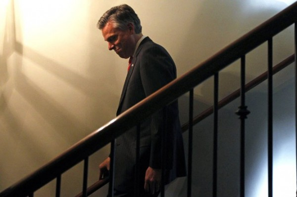 Republican presidential candidate former Utah Gov. Jon Huntsman descends stairs during an event at Virginia's on King restaurant, Sunday, Jan. 15, 2012, in Charleston, S.C. Huntsman will withdraw Monday, Jan. 16 from the race for the Republican presidential nomination. Campaign officials tell The Associated Press Huntsman will endorse Mitt Romney at an event in South Carolina on Monday morning.