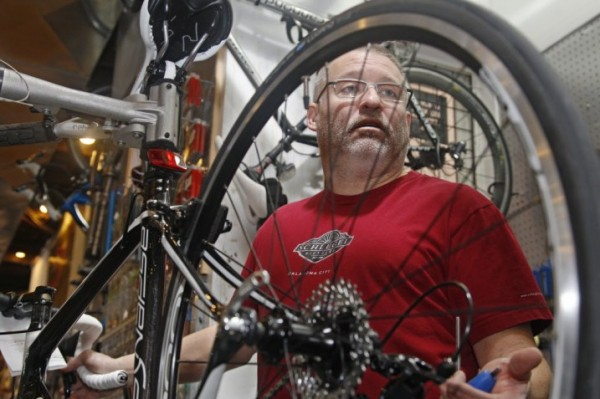 Steve Schlegel, owner of Schlegel Bicycles, answers a question while working on a bicycle in the store's pro shop, in Oklahoma City, Thursday, Jan. 26. Schlegel said he would favor paying less in taxes, but wondered how state services would suffer if a significant portion of state revenue were taken away.