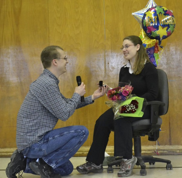 Bill Hensley proposes to Martel School secretary Rebecca Lussier at a scheduled Monday afternoon school assembly. She said yes in front of 300 cheering students.