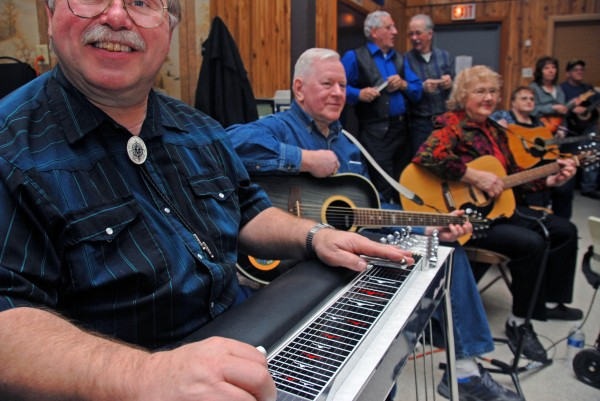 Ron Riens of Glenburn smiles as he plays during a Knights of Columbus Music Jam at the Knights' hall in Lincoln on Wednesday, Jan. 25, 2012. Held on alternate Wednesday nights, the events usually draw a few hundred people.