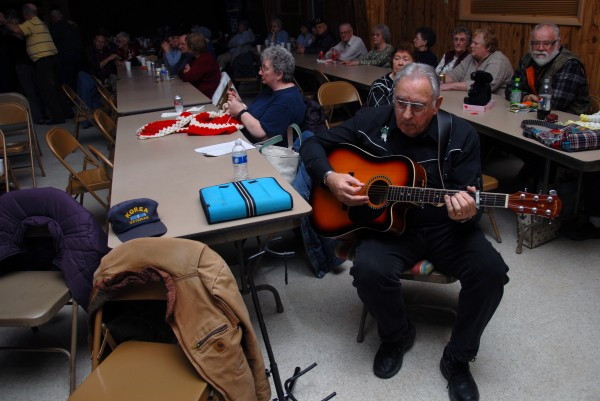 Donald Webb of Winn plays guitar and sings during a Knights of Columbus Music Jam at the Knights' hall in Lincoln on Wednesday, Jan. 25, 2012.