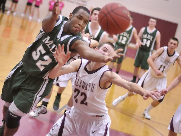 MDI's Jayson Burke (52) edges out Ellsworth's Brandon Braley (22) for a rebound with less than two minutes to go in their game in Ellsworth , Saturday night, Jan. 14, 2012.