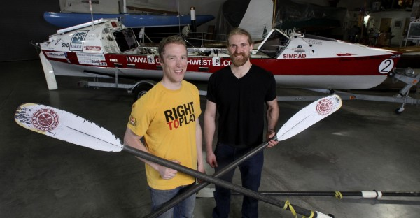 Jordan Hanssen (left) and Greg Spooner, two crew members of OAR Northwest,  rowed this boat across the Atlantic in 2006. They will attempt to set a new world for the same feat in December. Photo taken at the Working Waterfront Maritime Museum and Boat Shop in Tacoma on April 18, 2010.