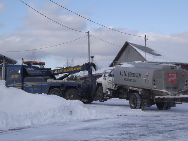 The C.N. Brown oil truck that was stolen from a fueling station in Dexter on Thursday is towed to a secure facility in Dexter by T and W Garage of Newport on Friday, Jan. 20, 2012. The truck was stolen on Thursday morning and was recovered by Dexter police on Friday.