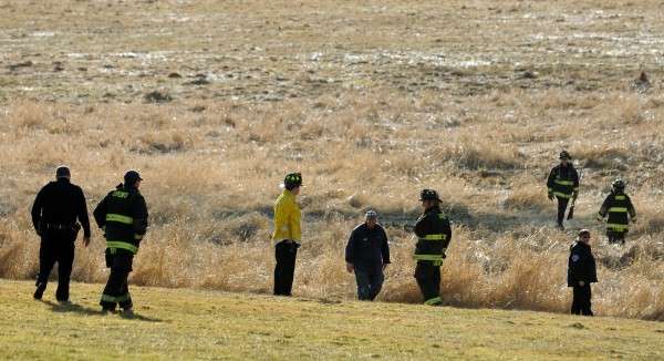 Orono Firefighters and University of Maine officials spread out across a field on Rangeley Road on the University of Maine campus after two subjects were seen setting fire to the field on Thursday, Jan. 26, 2012.