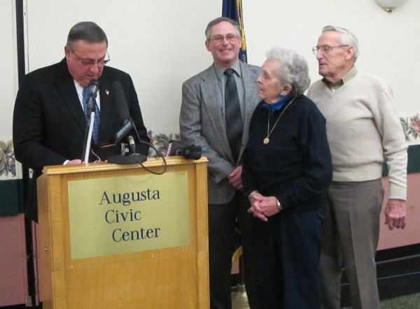 Bernard and Norma Shaw receive the 2012 Agriculture Commissioner's Distinguished Service Award from Gov. Paul LePage, as Commissioner Walt Whitcomb looks on.