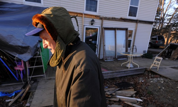 Raymond Phelps, 81, of Palmyra is being sued by the town because an addition on his home and a porch are partly on the town right-of-way along Route 100.