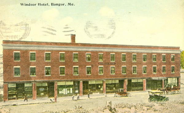 The opening of the new Windsor Hotel just eight months after the great fire destroyed the old one along with much of downtown Bangor in 1912 was a symbol of the confidence people had in the city's economic vitality.  The hotel was located on the corner of Harlow and Franklin streets down the street from the new John R. Graham building. Note the men working on the street curbing, the old autos and horse and wagon, and the rubble across the street where the new post office, which became city hall, would be built soon.