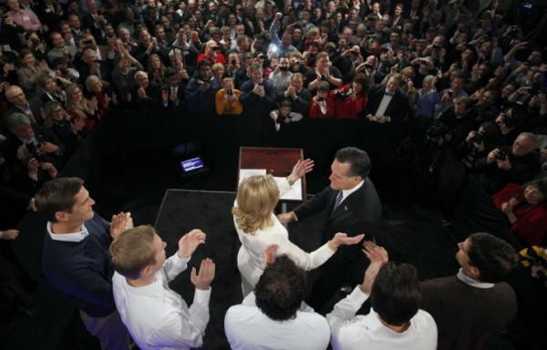 Former Massachusetts Gov. Mitt Romney reaches for his wife Ann as his sons, Josh, Ben, Craig, Tagg and Matt  look on during the Romney for President New Hampshire primary night rally at Southern New Hampshire University in Manchester, N.H., Tuesday, Jan. 10, 2012.
