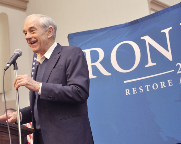 Republican candidate Ron Paul greets the crowd that turned out to meet him at the Brick Church on Union St. in Bangor on Friday.