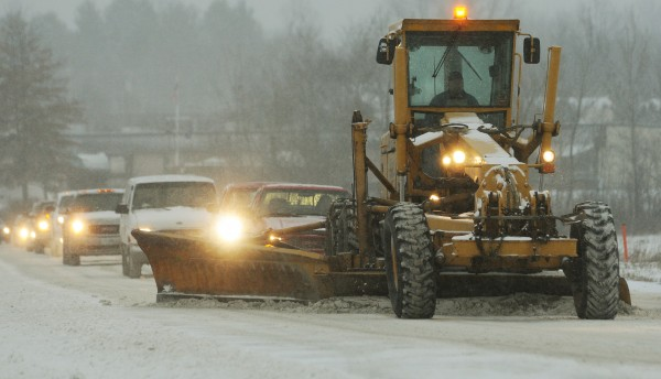A road grader plows snow along Odlin Road in Bangor on Thursday, Jan. 12, 2012.